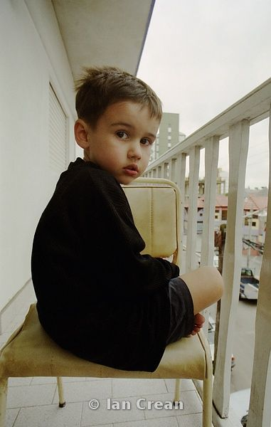 Boy on a Balcony