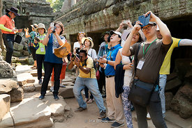 Tourists photographing the Ta Prohm Temple at Siem Reap, Cambodia.