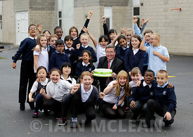 Oakgrove Primary School, Glasgow.28.10.15..Archie Blair of Abstract Securities, the developer of St Vincent Plaza, with the help of  Emily Lyon (11, grey cardigan) and Rachel Moore (11, white shirt) today cut a  giant celebration  cake to say thank you to the pupils of the  eco committee for their help  in opening St Vincent Plaza's public realm and re-planting trees from the site in the school's  playground.   30 children representing primaries 5 to 7 took part in the celebration. ..Free press use in relation to this story..Free PR use for Abstract / Skylark PR...More info from:.Pauline Gregory.Skylark Public Relations Ltd.Pauline@skylarkpublicrelations.com.www.skylarkpublicrelations.com.twitter.com/skylarkpr1.07833 490964..Picture Copyright:.Iain McLean,.79 Earlspark Avenue,.Glasgow.G43 2HE.07901 604 365.photomclean@googlemail.com.www.iainmclean.com.All Rights Reserved.No Syndication