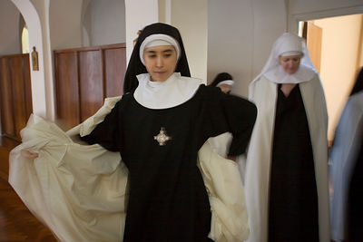 Mother Augusta changing into her robes