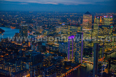 Close up aerial view of offices in Canary Wharf at night, London