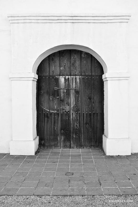 OLD DOOR SANTA BARABARA CALIFORNIA BLACK AND WHITE VERTICAL
