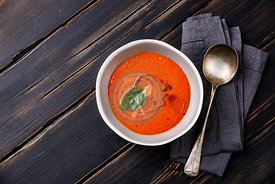 Gazpacho Tomato summer soup on wooden background copy space