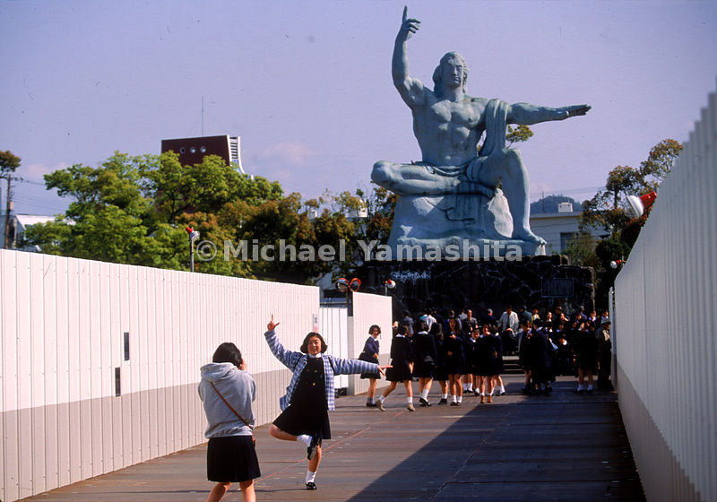 Visitng school children seem oblivious to the significance of the Nagasaki Peace Statue in the city's Heiwa Koen, Peace Park.