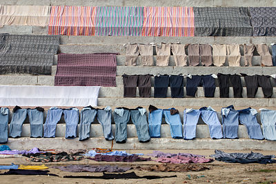 Laundry drying on the ghats aong the Ganges River, Varanasi, India.