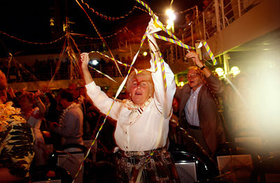 Passengers celebrate at a party on board the P&O Cruise Liner Oriana