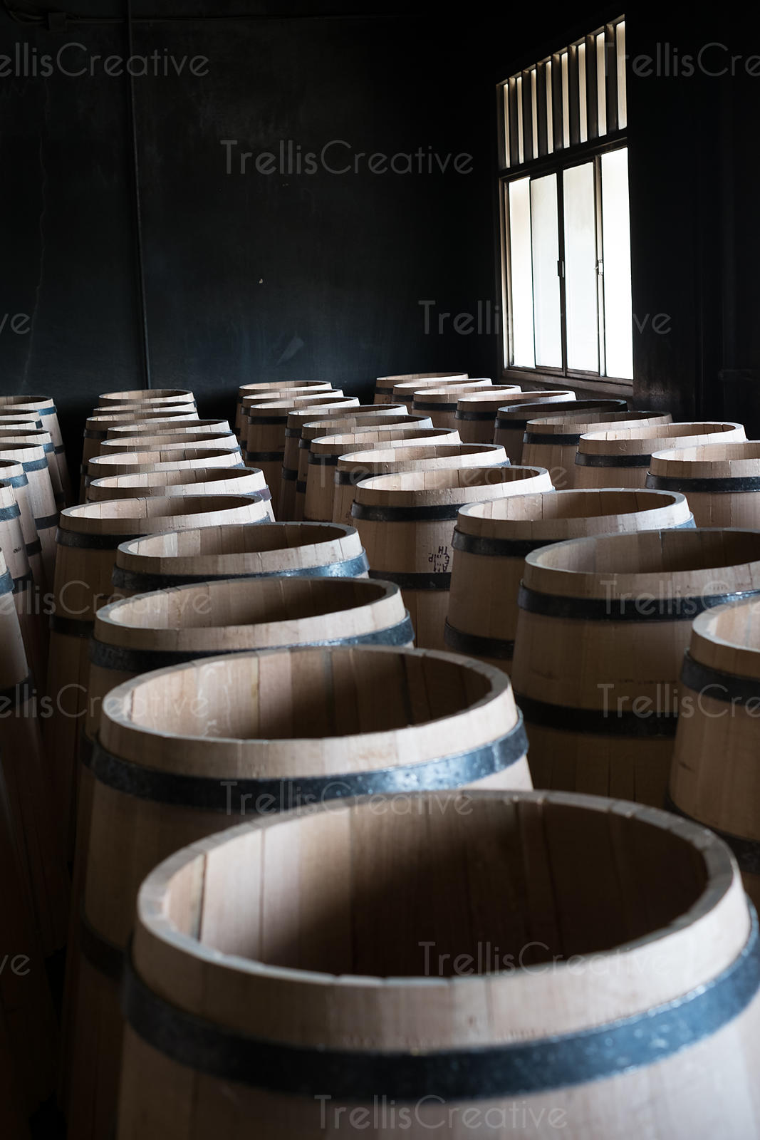 Freshly made wooden oak barrels in a cooperage