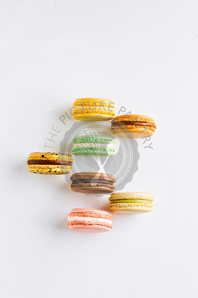 macarons of various tastes and colours on white
