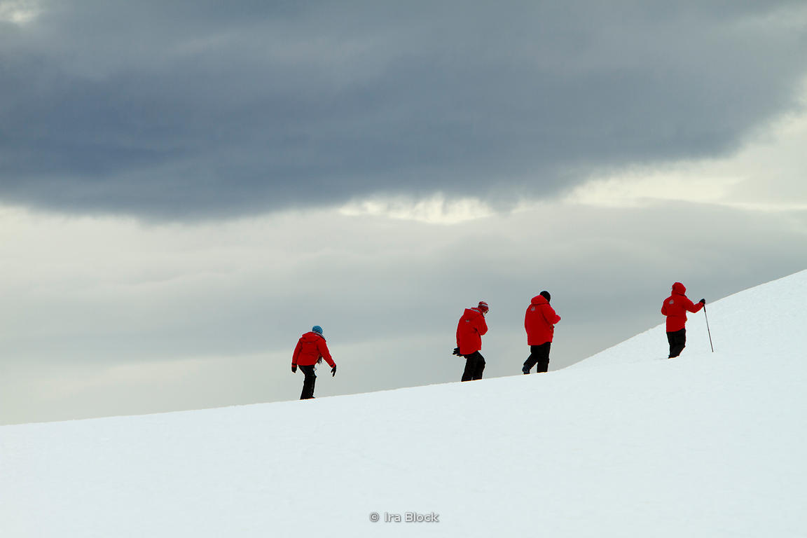 People hiking on Booth Island, at the west coast of the Antarctic Peninsula.