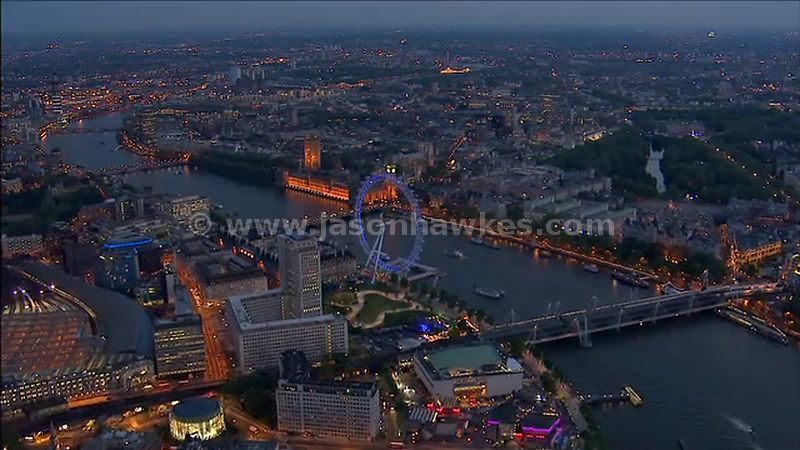 Aerial footage over Waterloo and the London Eye at night, London, England, UK