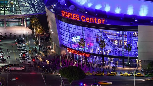 Close Up: Wide Shot: Intense Foot & Vehicle Traffic Swarming Staples Center In Neon Lights