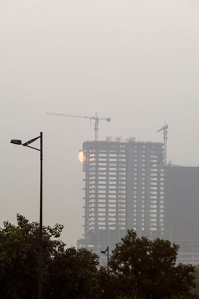 India - New Delhi - The rising sun and construction sites in Noida