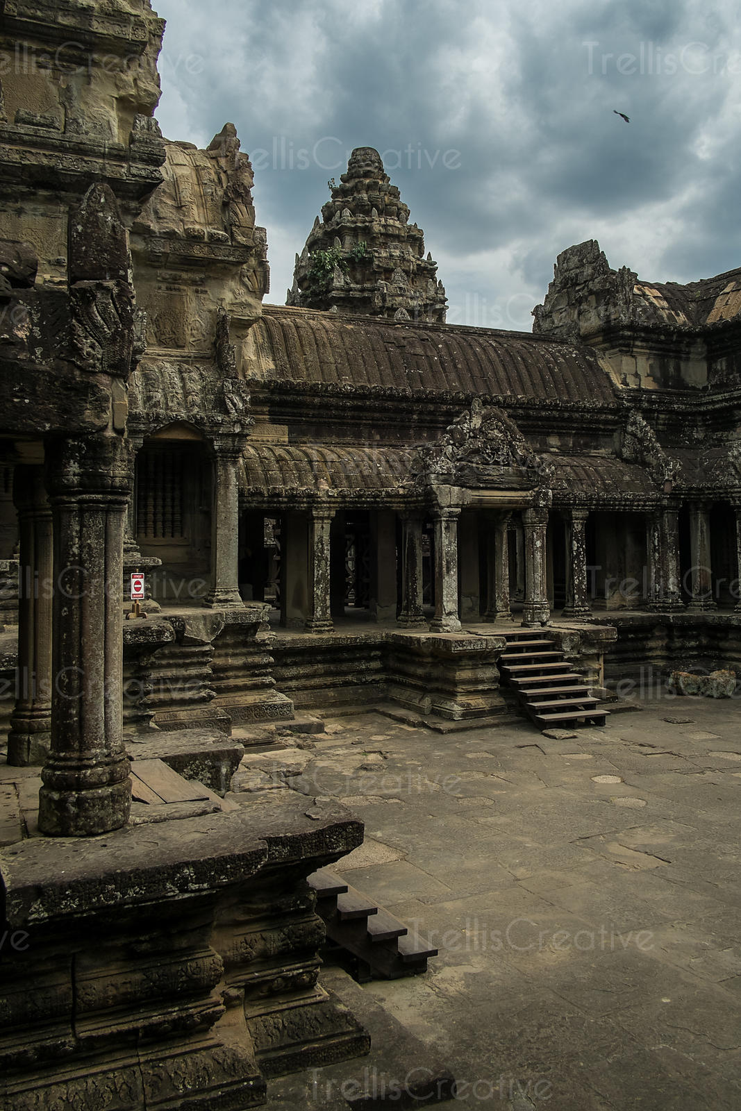 Old temple at Angkor Wat, Cambodia under dramatic storm clouds