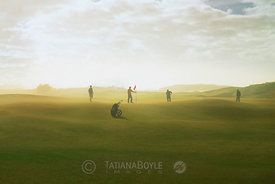 Golfers on putting green, Old McDonald Golf Course; Bandon Dunes, Oregon