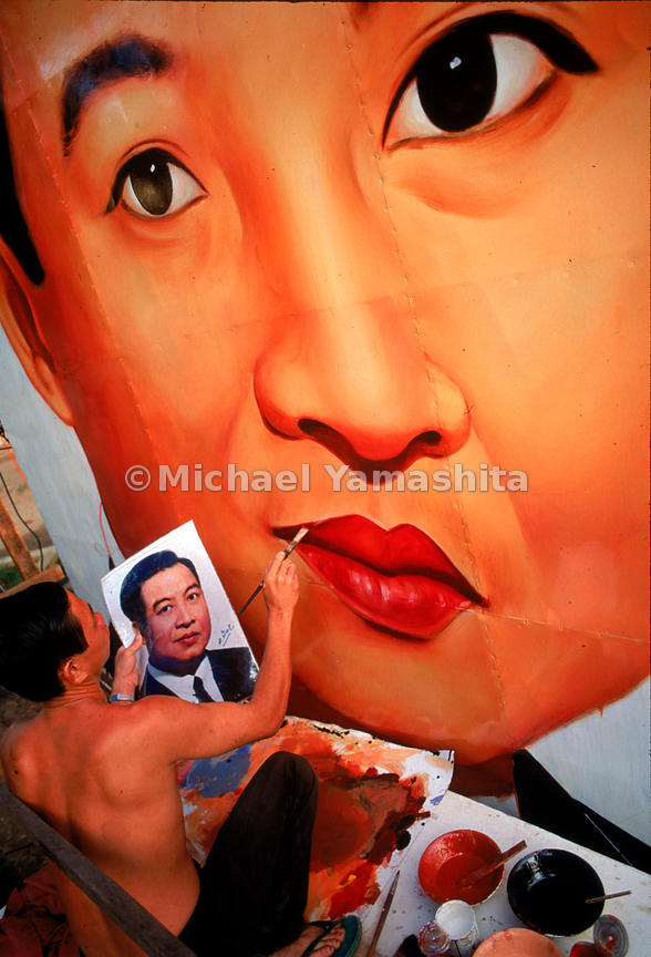 A poster artist puts the finishing touches on a likeness of Prince Sihanouk, celebrating his return in 1992 from a thirteen-year exile prompted by the Khmer Rouge takeover. Cambodia.
