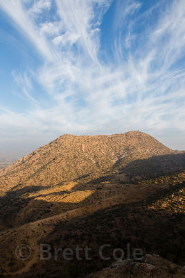 Sunrise in the desert ecosystem of the Aravali mountains above Bedhnath temple, Rajasthan, India