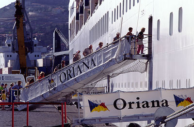 Passengers re-board the P&O Cruise Liner Oriana after it had berthes in Lisbon