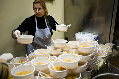 Greece - Athens - Volunteers prepare and serve potato soup for the poor and homeless in a Municipal Soup kitchen in Athens