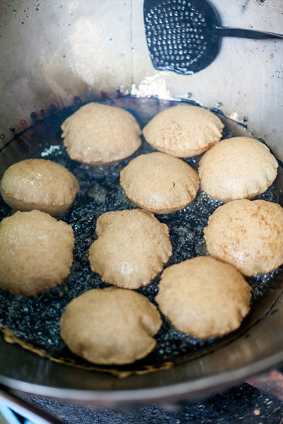 India - Delhi - Nagori (small puris) frying in oil at Ram Swarup a shop which has been  serving up breakfasts in the old city for over 70 years