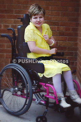 Portrait of a girl in a wheelchair on a patio