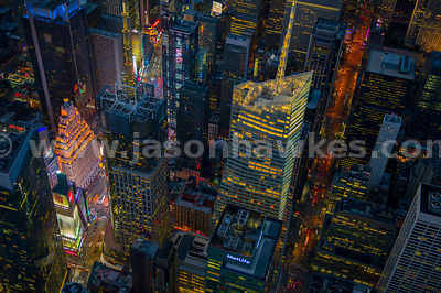 Aerial view of the Bank of America Tower and 4 Times Square at night