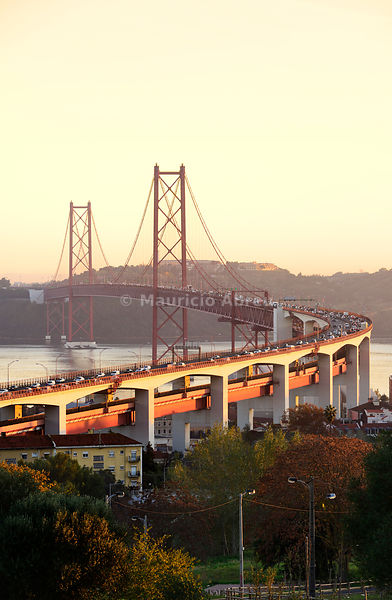 25 de April bridge (similar to the Golden Gate bridge) across the Tagus river, in the evening. Lisbon, Portugal