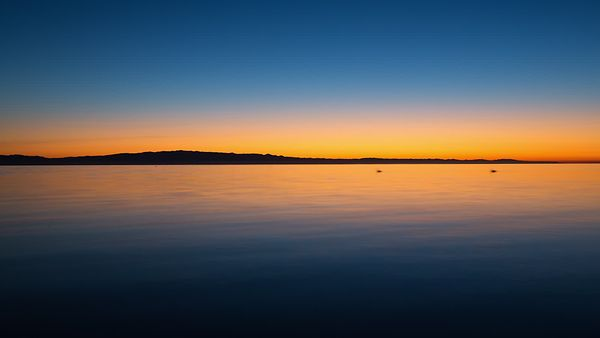 Wide Shot: Extended Dolly Movement Over A Golden Hour Salton Sea