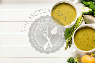 Vegetable cream soup on white rustic background