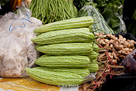 A pile of neatly stacked ampalaya for sale at the flower and produce market in Bangkok, Thailand.