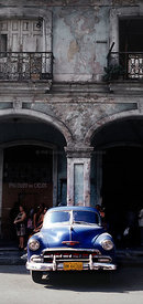 Havana Cuba street with dark blue car