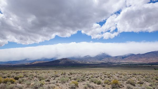 Wide Shot: Nimbostratus Clouds Build up at the Bottom of a Weather Trough Between Weather Blocking Mountain Ranges by the Eastern Sierras