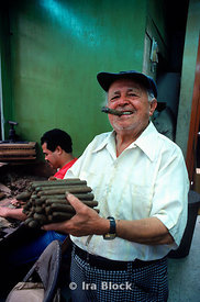 man with hand rolled cigars