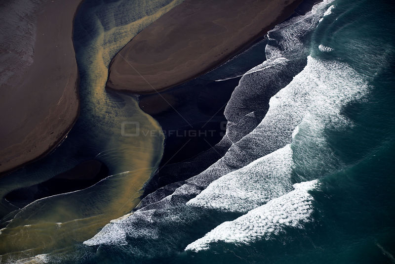 Aerial view of coastline and river, South West Iceland, June 2014.