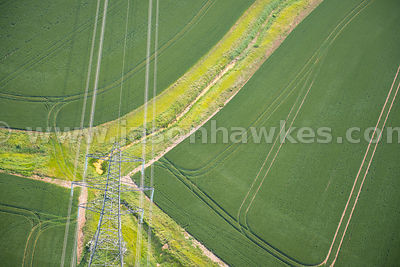 Aerial view of electricity Pylons in fields, Kent