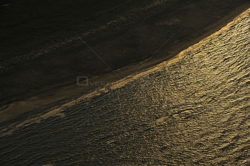 Aerial view over the Danube delta shoreline at dawn, Danube Delta rewilding area, Romania, June 2012