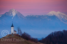 Twilight on the Kamnik-Savinja Alps (Storžič peak on the left) with Church of St. Primož, Jamnik.