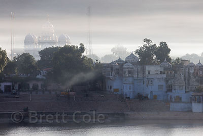 Morning fog over the Gurudwara Singh Sabha Sikh temple, from Ganahera, Pushkar, Rajasthan, India