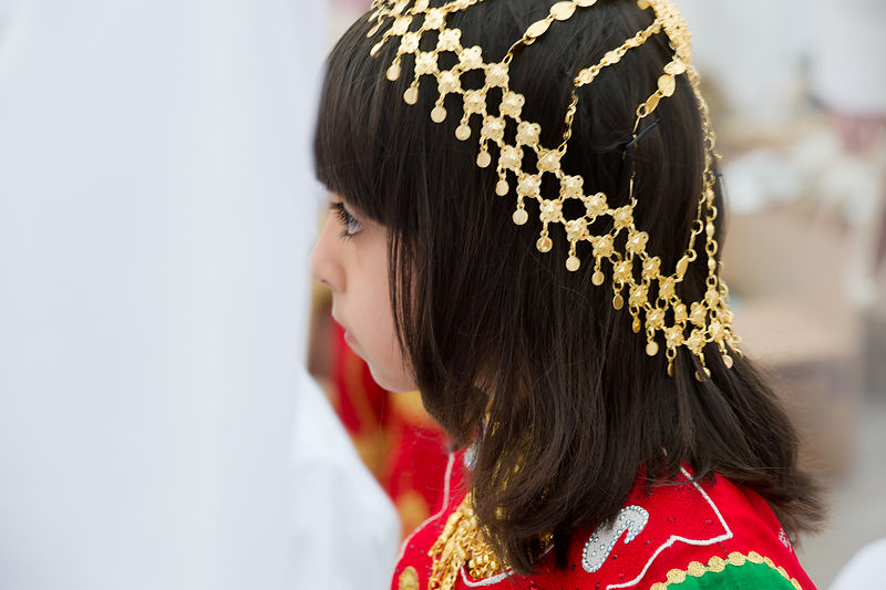 Emirati girl wearing traditional gold head jewellery, Sharjah Heritage Days cultural festival, Heritage Area, Sharjah, Emirates