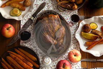 Traditional festive dinner with roasted chicken, apples and verious garnishing