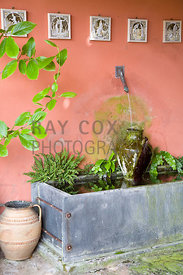 Water spout, urn & trough in loggia