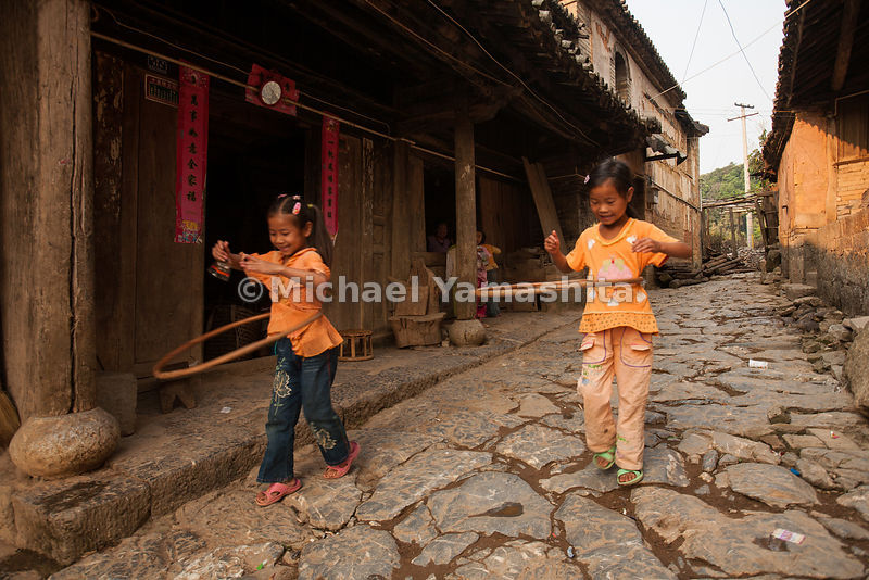 In the village of Yiwu, in Yunnan Province, children play on remnants of the original Southern Tea Horse Road, which began near here.
