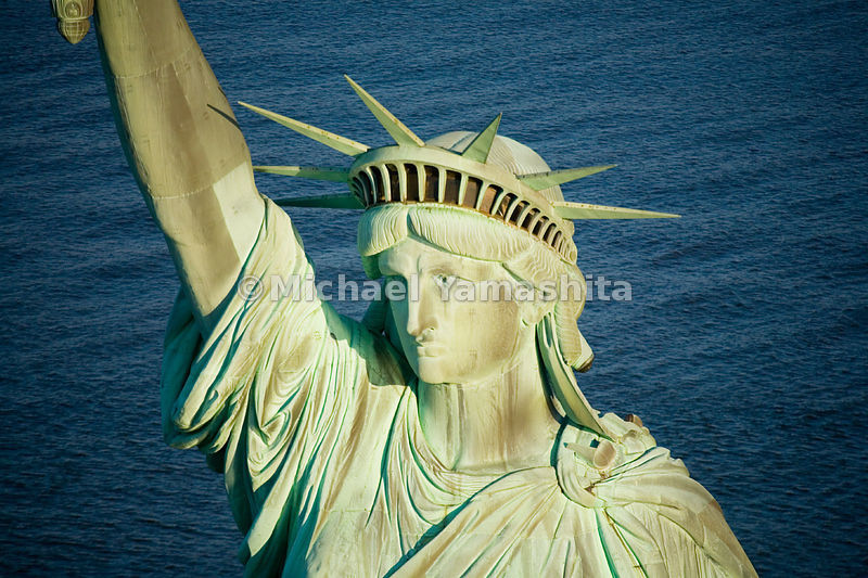 With a face said to have been modeled after the mother of her sculptor, Frederic Bartholdi, the Statue of Liberty wears a crown with seven rays, symbolizing the seven seas and seven continents.