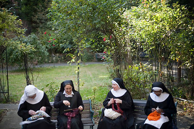 Nuns chat, sew and knit