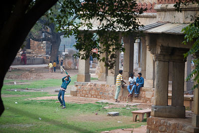 India - New Delhi - Boys play cricket among the ruins of Hauz Khas Village