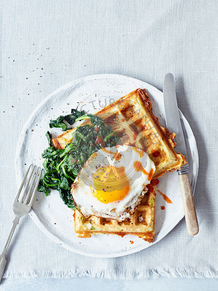 Cheese and courgette waffles with spinach and fried egg