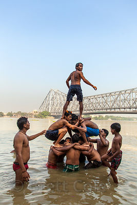 A group of swimmers form a pyramid in the Hooghly River near Howrah Bridge, Kolkata, India.