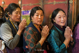 Women pray at Dreprung Monastery in Lhasa, Tibet.
