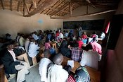Classroom full of adult students learning about sustainalble agriculture. Rwanda