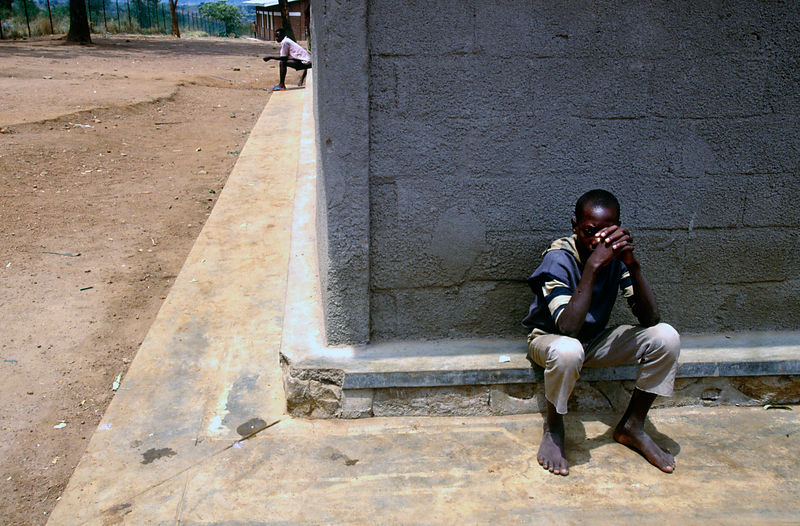 Rwanda - Kigali - Gitarama - Two youths accused of Genocide crimes sit in an exercise yard in prison awaiting trial