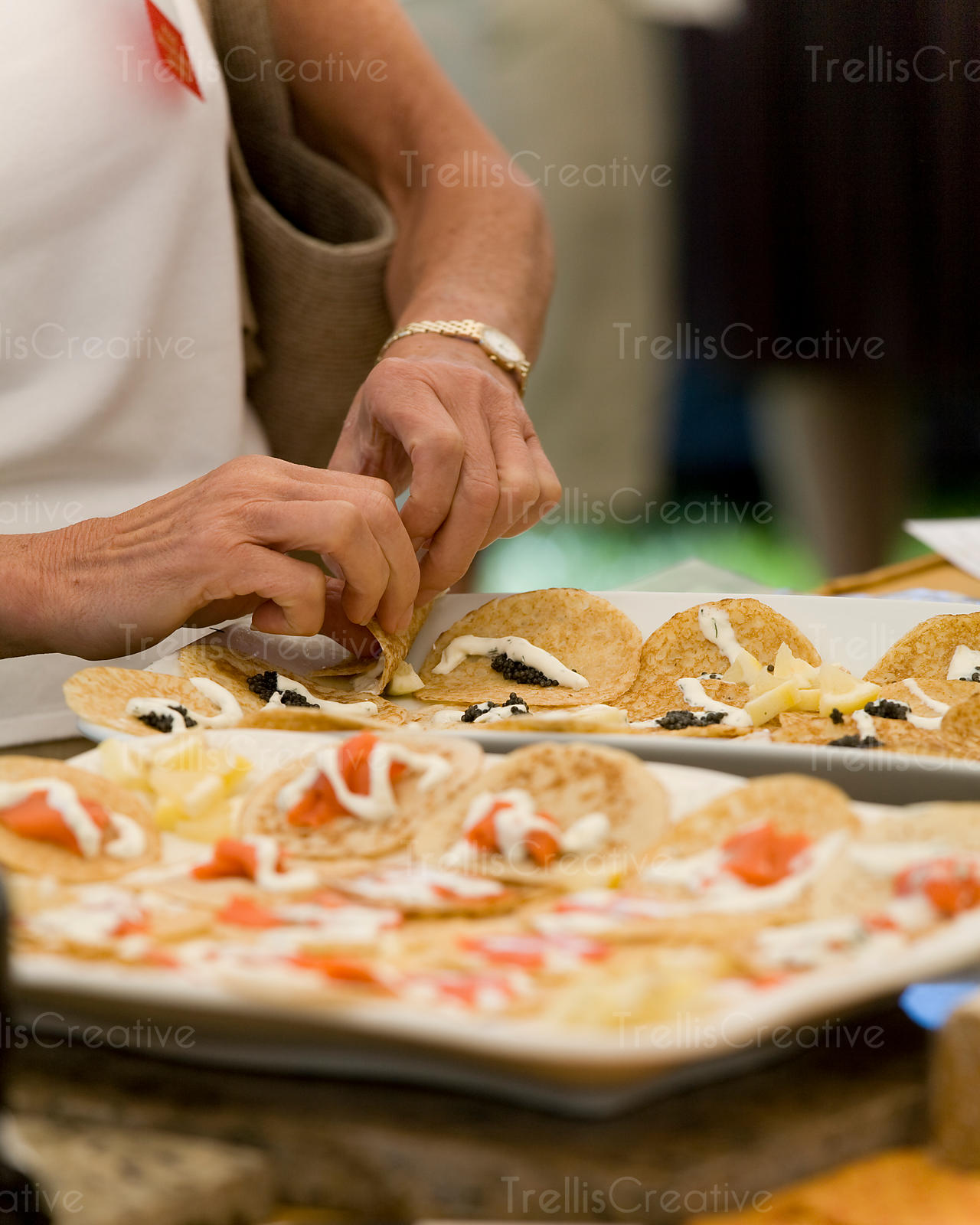 A woman sampling caviar tacos
